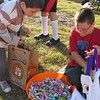 CATHY SPAULDING/Muskogee Phoenix<br /> Gabriel Horgeshimer, 6, left, and Ricardo Reynoso, 7, pick some candy at a booth at Connors State College's Fall Festival on Monday. Booths representing 11 campus clubs, classes and organizations offered treats to youngsters during the Fall Festival at the College's Port Campus.