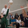 Phoenix special photo by Abigail Washington<br /> Muskogee's Carsen Lamont goes up for the ball against Bartlesville defenders in Tuesday's match at the MHS volleyball gym.