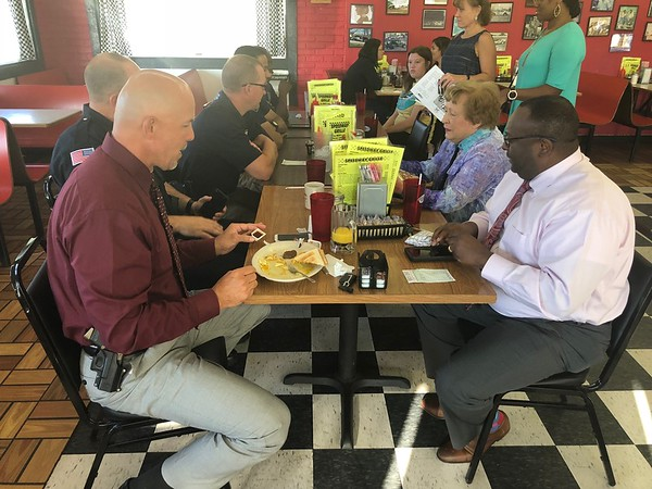 CHESLEY OXENDINE/Muskogee Phoenix<br /> Muskogee Police Department officers join visitors at Speedway Grille for coffee Wednesday morning during the National Coffee With A Cop event.