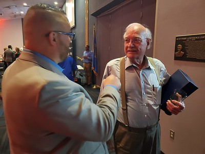 CHESLEY OXENDINE/Muskogee Phoenix Muskogee County District 1 Commissioner Ken Doke, left, congratulates Dick Morris, winner of the 2019 Lifetime Achievement Award at the 22nd annual Business and Industry Banquet and Award ceremony Thursday night.
