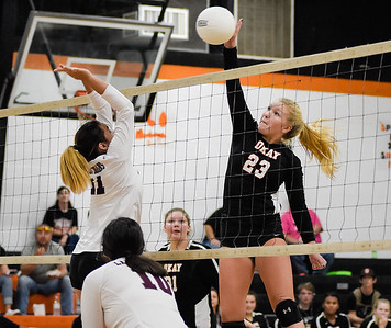 CHRIS CUMMINGS/Phoenix Special Photo Okay's Lexi Erb and Sequoyah's Jamie St. Pierre battle it out at the net Thursday in a Class 3A regional final volleyball match at Okay.