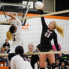 CHRIS CUMMINGS/Phoenix Special Photo<br /> Okay's Lexi Erb and Sequoyah's Jamie St. Pierre battle it out at the net Thursday in a Class 3A regional final volleyball match at Okay.