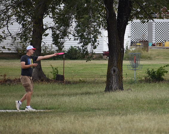Staff photo by Mark Hughes<br /> Curtis Hartshorn launches a plastic disc toward the goal at Checotah's sports complex recently. The city's five-year plan includes updating the disc golf course to draw regional tournaments. Other improvements include two soccer fields, four baseball fields, a BMX dirt trail and a pavilion.