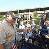 CATHY SPAULDING/Muskogee Phoenix<br /> Larry Ross shows Creek Elementary students how his Model T Ford engine thermometer works. He brought his flivver to the school's Transportation Day on Friday.