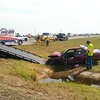Staff photo by Wendy Burton<br /> A 1994 Nissan is loaded onto a wrecker at the intersection of U.S. 64 and Smith Ferry Road on Thursday afternoon after the car, driven by Norma Hale, 67, of Muskogee, ran a red light and hit a 2005 Ford that was turning left from U.S. 64 onto Smith Ferry Road, according to an Oklahoma Highway Patrol trooper's report. The Nissan then hit a utility pole, and Hale and her passenger, Chris Allison, 59, of Muskogee, were taken to Saint Francis Hospital in Tulsa with head and trunk internal injuries, the report says. The driver and passenger in the Ford were not injured, the report says. Hale's and Allison's conditions were not available Thursday evening.