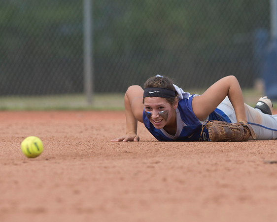 Phoenix special photo by Von Castor<br /> Haskell's Marissa Smith watches a pop fly that she narrowly missed catching roll away from her Thursday afternoon against Savanna at ASA Hall of Fame complex in OKC.