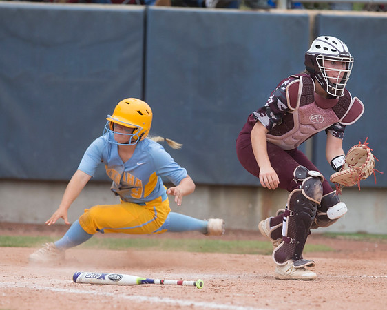 Phoenix special photo by Von Castor<br /> Oktaha's Karli Ashing slides around Kellyville's Madison Neighbors on Thursday in the Class 3A state quarterfinals. The Lady Tigers won 8-3.