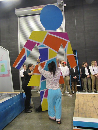 Staff photo by Cathy Spaulding<br /> Students from Tulsa's Edison Preparatory School move massive wooden mother figures after performing Thursday at the Oklahoma Secondary Schools Activities Association regional one-act play competition. About 300 high school students from Muskogee, Bixby, Broken Arrow, Sand Springs, Owasso and Tulsa Preparatory School competed in the Oklahoma Secondary Schools Activities Association regional one-act play competition, held Thursday at Muskogee Little Theatre. Each school cast and crew was given 45 minutes to set the stage, perform and strike the stage.