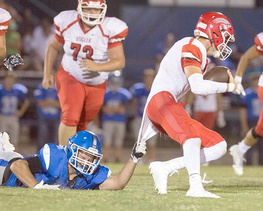 VON CASTOR/Special to the Phoenix Checotah's Malik Carr is tackled by Stigler's Lakin Bass after a long pass reception Friday night at Checotah.