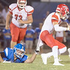 VON CASTOR/Special to the Phoenix<br /> Checotah's Malik Carr is tackled by Stigler's Lakin Bass after a long pass reception Friday night at Checotah.
