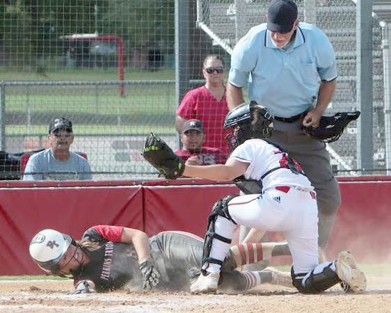 JOHN HASLER/Special to the Phoenix<br /> Hilldale catcher Drew Riddle makes the tag on Perkins-Tryon's Madison Shipp at the plate. The tag led to a double play.