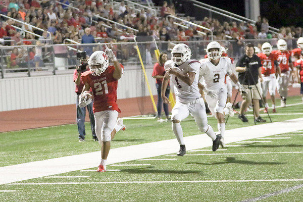 JOHN HASLER/Special to the Phoenix<br /> Fort Gibson's Tavien Woodward outraces the Muldrow defense for a touchdown during Friday's game.