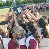 VON CASTOR/Special to the Phoenix<br /> Members of the 2018 Sequoyah Tahlequah Lady Indians hoist the 3A state championship trophy moments after defeating Washington 11-1 at Firelake in Shawnee.