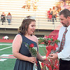 CATHY SPAULDING/Muskogee Phoenix<br /> Tiffany Wilson accepts a bouquet from her father, George Wilson, after being chosen Fort Gibson all-school homecoming queen on Friday.
