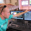 Nick Luttrull shows the computer work that goes into preparing Sunday worship at First Baptist Church of Muskogee.