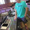 Nick Luttrull shows the sound board First Baptist Church of Muskogee uses for Sunday worship.