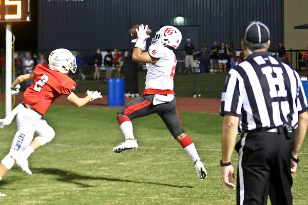 Phoenix special photo by John Hasler<br /> Fort Gibson's Elijah Wright, right, grabs a pass for a two-point conversion during the Tigers' game against Metro Christian.
