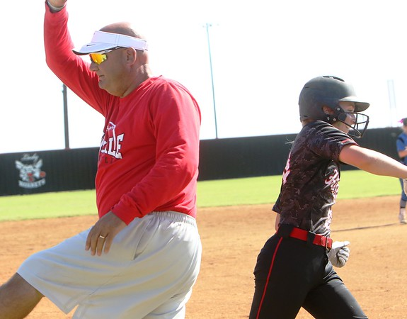 Phoenix special photo by John Hasler<br /> Hilldale coach Darren Riddle, left, and his daughter Drew hive five each other after the daughter's home run against Miami in the Hilldale Class 4A regional.
