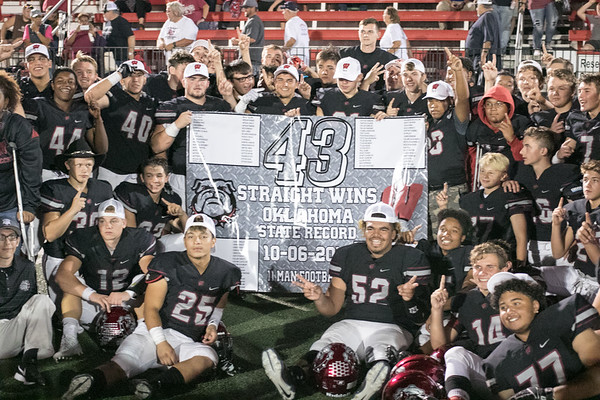 Special photo by Shane Keeter<br /> The Wagoner Bulldogs celebrate 43 straight wins after beating Tulsa McLain 62-22, breaking the state record for most consecutive victories.