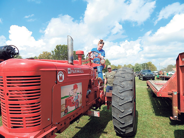 Mary Cummins came from Inola to participate in the tractor pull at the Fourth annual Wagoner Fall Festival and Tractor Show at Dunbar Park on Saturday. The show also featured ice cream making, hay baling and corn-shucking.