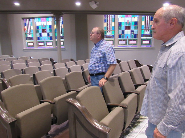 CATHY SPAULDING/Muskogee Phoenix<br /> Contractor Jeff Williams, left, and First Baptist Church Pastor Johnny Derouen look around First Baptist's updated sanctuary, which includes padded seats.