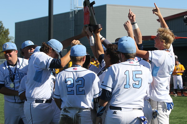 Phoenix special photo by Von Castor<br /> The Oktaha Tigers baseball team hoists the Class A fall baseball championship trophy after beating Latta 5-1 on Saturday in Mustang.
