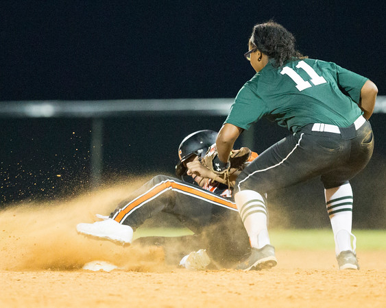 Special photo by Von Castor<br /> Muskogee's Dee Emarthle, right, applies the tag to Tahlequah's Kortney Dry in the bottom of the seventh inning of Monday's game in Tahlequah. Dry was safe on the play and would score the winning run as the Lady Tigers beat the Lady Roughers 5-4.