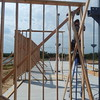 Staff photo by Mark Hughes<br /> Phillip Gordon of Boswell Construction of Fort Gibson frames a wall for the new 7,000-square-foot visitor center at the Honey Springs Battlefield in Rentiesville.