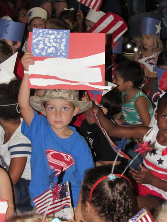 Staff photo by Cathy Spaulding<br /> Early Childhood Center pupil Nicholas M. Isle wears his father's Marine hat as he waits for the ECC's annual patriotic parade Friday. His father is Sgt. Nicholas A. Isle.