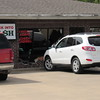Staff photo by Cathy Spaulding<br /> A 2011 Hyundai Santa Fe struck the front wall and window of Check Into Cash, 1201-B N. York St. on Friday afternoon, said Muskogee Police spokesman Lincoln Anderson.<br /> He said the driver of the vehicle, Carol Foltz, 69, of Muskogee, reported get- ting out of the vehicle before it lunged forward into the building.<br /> Anderson said there were no injuries.
