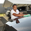 Staff photo by Cathy Spaulding<br /> Carnell Brooks shines a sport utility vehicle at his detailing business. He recalled learning about paint and body work from his father.