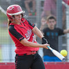 Phoenix special photo by Von Castor<br /> Hilldale's Kenzie Mize blasts a three-run home run during the Hornets' 14-4 win on Tuesday against Locust Grove.