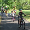 Staff photos by Cathy Spaulding<br /> Members of the Milligan family, from left, Sidney, Ronald Sr., Maya, Ronald Jr., and Tiffany, ride along a southern Muskogee bicycle trail, a trek the family often enjoys together.