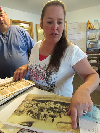 Staff photo by Cathy Spaulding<br /> Sissy Swafford, office manager for Porum Public Works Authority, points out details of a picture from Porum's outlaw past. The town celebrates its most notorious outlaw during Belle Starr Days.