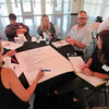 Staff photo by Cathy Spaulding<br /> Laura O'Bannon of the Eastern Workforce Board takes notes Wednesday while others, from second left, Dan Morris, Jason George, Danna Minnick, Lisa Smith, Daryl Legg and Carrie Willis share ideas about job skills during a Manufacturing Workforce Summit.