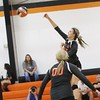 Phoenix special photo by John Hasler<br /> Kirstyn Anderson delivers a long kill as Alli Taylor looks on for Okay against Locust Grove on Thursday .
