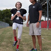 Special photo by Von Castor<br /> Hilldale football player Max James holds a smartphone containing an application from Sway Medical that takes baseline measurements for balance, which in the event of a possible concussion event in a game can be used to make a sideline determination of a concussion. The system is being used by programs at both Hilldale and Muskogee this fall.
