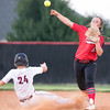 Phoenix special photo by Von Castor<br /> Hilldale's Taylor Sanchex, flips to first for the double play after forcing out Wagoner's Morgan Schilling during the first game of Monday's doubleheader.