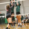 Phoenix special photo by John Hasler<br /> Muskogee's Wren Seabolt, right, and Jalayiah Collins block the shot of Claremore's Riley Renfro during Monday's match at Muskogee High School.