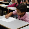Staff photo by Mark Hughes<br /> Rance Reynolds, third grader at Tony Goetz Elementary School, writes a letter Tuesday to a recruit at Marine Corps Recruit Depot in San Diego. All 378 students at the school are participating in this morale boosting effort.