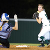 Phoenix special photo by Von Castor<br /> Muskogee's Brookelyn Gilmore prepares to throw to first for a double play as Stillwater's Gracie Orr slides into second base Tuesday evening at Muskogee High School.