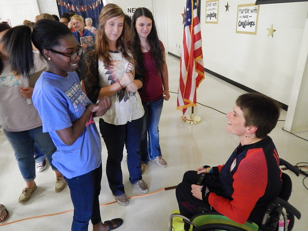 "Staff photo by Mark Hughes<br /> Warner High school student Dorarisha Tolbert talks to Cassie Mitchell on Tuesday about how Mitchell has overcome challenges in her life. After Mitchell's speech, Tolbert said that Mitchell's story ""was mind blowing"" and that ""it was crazy that someone could do all that."" Mitchell won a silver and bronze medal in the discus and club throw, respectively, in this year's Paralympics held in Rio de Janeiro."