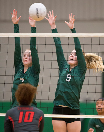 Special photo by Von Castor<br /> Muskogee's Madison Wiebe, left, and Emma Hamilton go up for the block during the Lady Roughers' match on Monday against East Central. Muskogee won the match by scores of 25-16, 25-11 and 25-10.