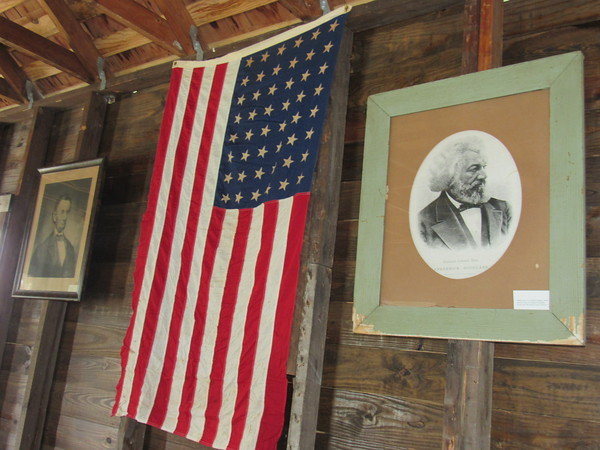 Staff photo by Cathy Spaulding The renovated Oak Grove School house features a period-appropriate 48-star American flag, as well as portraits of President Abraham Lincoln and abolitionist Frederick Douglass. Three Rivers Museum will have an open house for the school on Saturday.