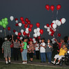 Special photo by Wendy Burton<br /> Visitors to the National Day of Remembrance for Murder Victims held Thursday at Oasis Community Church release balloons in their loved ones' honor.