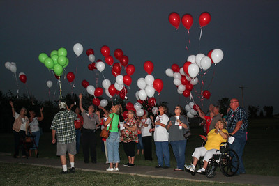 Special photo by Wendy Burton Visitors to the National Day of Remembrance for Murder Victims held Thursday at Oasis Community Church release balloons in their loved ones' honor.
