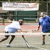 Phoenix special photo by John Hasler<br /> Father Leon Ahanotu of Wagoner returns a volley as playing partner Dice Dawson looks on in a doubles match of the Dice Dawson International Tennis Tournament on Saturday at Spaulding Park. Ahanotu is a native of Nigeria.