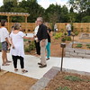 Staff photo by Harrison Grimwood<br /> Jim Thompson, the man who designed the Beatrice Sheddan Children's Garden at Honor Heights Park Butterfly Papilion, talks with a donor to the garden and representatives of Sheddan's trust from Oklahoma City as they tour the newly opened dirt classroom.