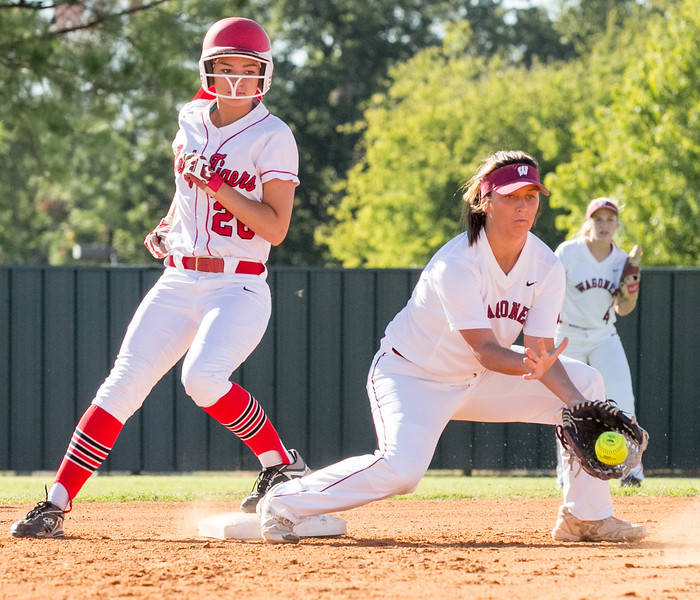 Phoenix special photo by Shane Keeter<br /> Fort Gibson's Lauren Diebold gets in ahead of the throw to Wagoner's Madyson Robertson in Tuesday's game.