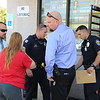 Staff photo by Harrison Grimwood<br /> Muskogee Police Department investigators talk with a Pop-N-Go employee following a Wednesday afternoon armed robbery at Pop-N-Go on South 24th Street and West Okmulgee Avenue.